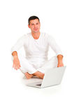 Man dressed in white sitting Stock Images