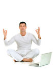 Man dressed in white sitting Royalty Free Stock Image