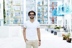 Man dressed in white t-shirt stock image