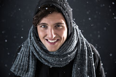 Man dressed in winter clothes with snow Stock Photo