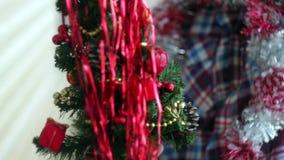 Man dresses beautiful little glowing Christmas tree stock video