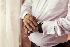 Man dresses a butterfly,man butterfly clothes,businessman putting on bow tie. Suit, Han. Ds, care, tie, to correct, to adjust, fashion, bow stock photography
