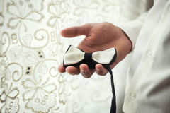 Man dresses a butterfly,man butterfly clothes,businessman putting on bow tie. Suit, Han stock photography