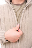 Man dressing coat Stock Images