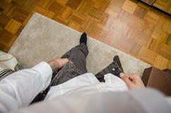 Man dressing, putting pants on. Self POV Stock Image
