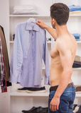 Man in dressing room Stock Photography