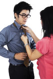 Man dressing up by help his assistant Royalty Free Stock Photo