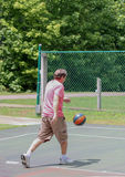 Man dribbles basket ball Royalty Free Stock Images