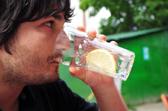 Man drikning. Image of an young man drinking lemonade Royalty Free Stock Images
