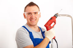 Man with drill Stock Images