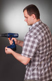 Man with a drill Stock Image