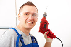 Man with drill Royalty Free Stock Images