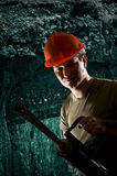 Man with drill Stock Photo