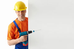 Man with a drill. Builder in helmets with a drill stock images