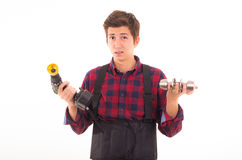Man with drill and door knob on a white background Royalty Free Stock Images
