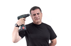 Man with a drill machine Stock Photo