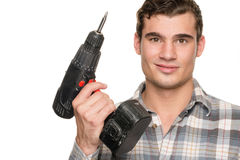 Man with drill machine. Smiling young man with drill machine in front of white background Stock Images