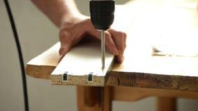 Man drill wood stock video