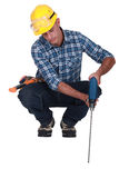 Man drilling into floor Stock Photo