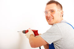 Man drilling hole Royalty Free Stock Photo