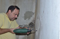 Man Drilling a Hole Royalty Free Stock Image