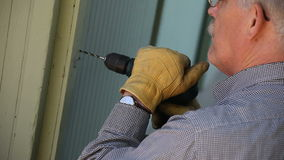 Man drilling a hole stock footage