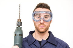Man drilling Stock Images