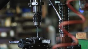 Man drilling in steel plate with bench drill stock footage