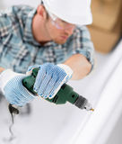 Man drilling the wall Stock Images