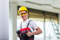 The man drilling the wall with drill perforator Royalty Free Stock Photos