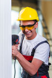 The man drilling the wall with drill perforator Royalty Free Stock Images