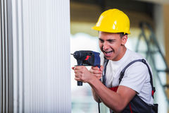 The man drilling the wall with drill perforator Stock Photography