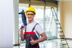 The man drilling the wall with drill perforator Stock Photo
