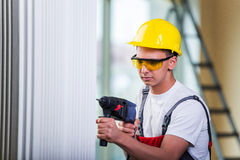 The man drilling the wall with drill perforator Royalty Free Stock Photography