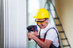 The man drilling the wall with drill perforator Stock Photos