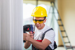 The man drilling the wall with drill perforator Royalty Free Stock Image