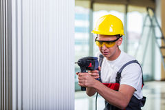 The man drilling the wall with drill perforator Royalty Free Stock Photo