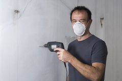 Man Drilling Wall - Horizontal Royalty Free Stock Photography