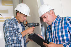 Man drilling wall with impact drill. Man drilling the wall with impact drill Royalty Free Stock Image