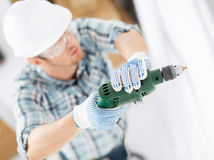 Man drilling the wall Royalty Free Stock Photography