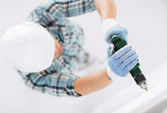 Man drilling the wall Royalty Free Stock Photos