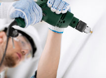 Man drilling the wall Stock Photo