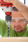 Man drilling wood Stock Photo