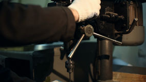 Man drills a detail on a drilling machine stock video footage