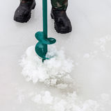 Man drills  hole in ice Royalty Free Stock Photography