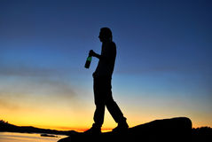 Man drink alcohol on the shore Royalty Free Stock Photography