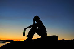 Man drink alcohol on the shore Stock Photo