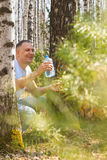 Man drink birch sap Stock Image