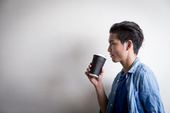 Man  drink coffe and look Stock Photos