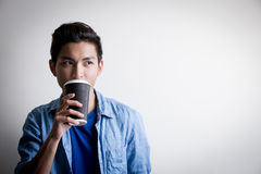 Man  drink coffe and look Stock Image